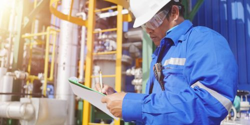 Production engineer to working in petroleum refinery plant to check equipment in factory and record to check sheet